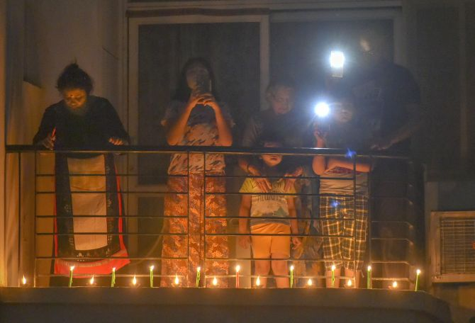 People lit lamps in their balcony